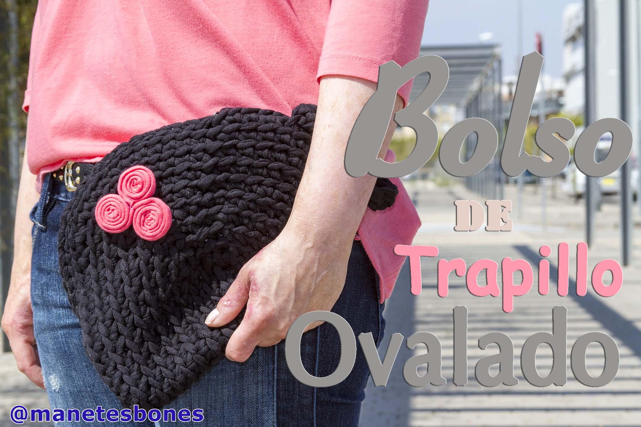 ... trapillo negro con un detalle de un trisquel de trapillo color coral