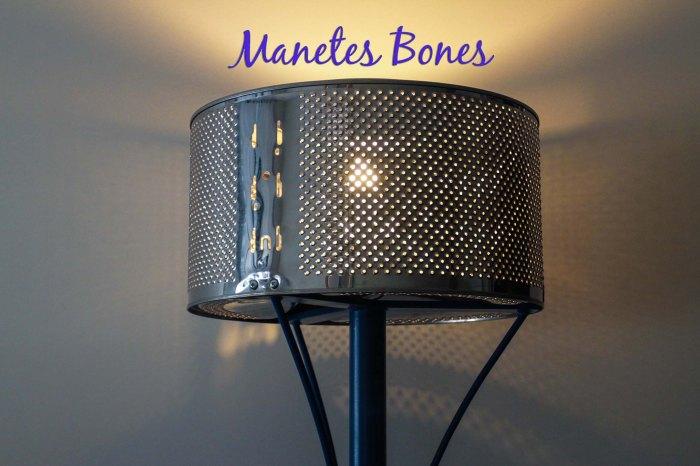 Lámpara hecha con un tambor de lavadora